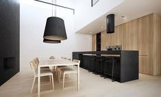 wood-grain modern cabinets (no hardware) & vent hood above cooktop