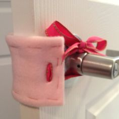 Baby room door muff: fleece folded in half and edges sewn, with ribbons to hold it on - easy enough :)