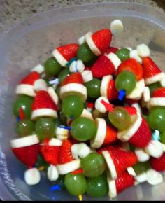 Grinch Kabobs! Party toothpicks with green grapes, banana slices, strawberries, and mini marshmallows. (A friend suggested small jicama pieces if you want a vegan version)