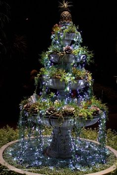 DIY succulent fountain - Fill a fountain with succulents and then put small white Christmas lights on top to make it look like glowing water. Creative Outdoor Ideas - outdoor garden ideas and DIY decorating tips.