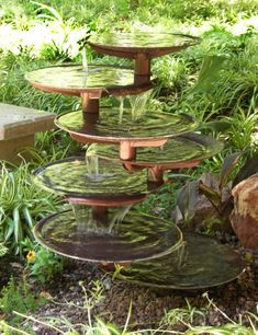 This seven tiered garden fountain has multiple levels of water falls.