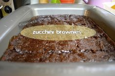 Flourless Zucchini Brownies made with almond butter, grated zuchinni, honey, egg, vanilla, and carob chips.