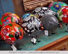 These Brazilian painted-gourd chickens remind us of #Navajo folk art roosters
