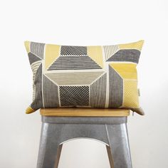 For this spring, add a fresh and colorful accent to any room. This decorative pillow cover is made with a beautiful printed geometric pattern canvas in mustard yellow, black, charcoal gray, taupe and off white background on the front. The contrasting back will feature the solid fabric of your choice and availaible options are: charcoal, cream, natural and taupe.  SPECIFICATIONS: ▲ Handmade by us. ▲ 12 x 18 (30 x 45 cm) pillow cover {made to fit this pillow insert size}. ▲ Printed canvas…