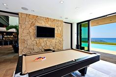 Billiards room with picture window