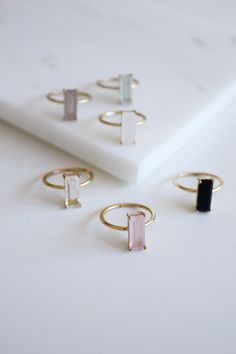 Dainty and delicate gemstone rings that come in 6 different colors. The rings are made out of sterling silver and are available with 14k gold plating. Very simple and chic.