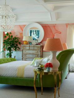Love this eclectic room! The watercolor effect on the wall, the green velvet headboard...