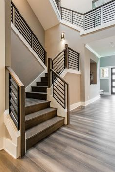 Part of the Oak Pointe Modern Metal Collection, Linear Metal Panels offer a modern industrial look to staircase designs. Pre-assembled panels showcase a 'welded' look that complements modern décor. Staircase Railing Design, Interior Stair Railing, Modern Stair Railing, Home Stairs Design, Metal Stairs, Staircase Remodel, Staircase Makeover, Staircase Railings, Modern Stairs