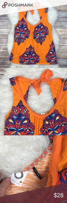 """Anthropologie Akemi + Kin Orange Rosae Tank Good condition Anthropologie Akemi + Kin Orange Rosae Tank. Size Small. Oversized fit with tie back bow. 100% cotton. Bust 38"""", length 25.5"""". Some minor pilling under arms seen in picture. No trades, offers welcome. Anthropologie Tops Tank Tops"""