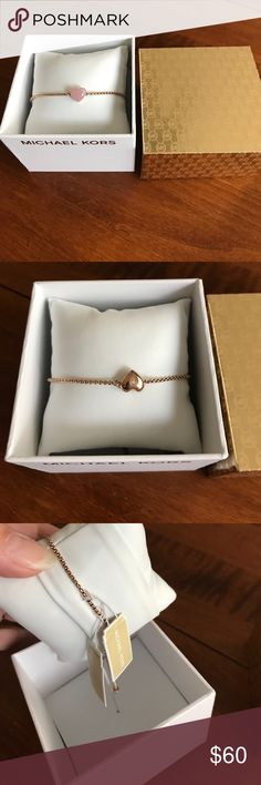 Michael Kors Rose Gold Slide Bracelet Beautiful bracelet that's reversible with rose gold heart and clear stone on one side and pink semi precious stone on the other with Adjustable slide. Michael Kors Jewelry Bracelets