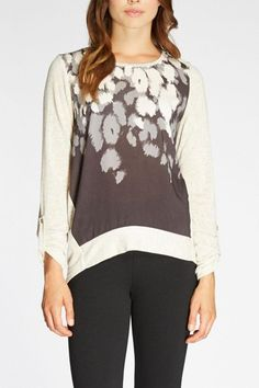 Abstract print top has a crepe de chine front with a soft knit body and back. This lightweight top is slightly higher in front and lower in back with a flattering silhouette. The color is black and gray with ivory. Perfect with the season's gray pants.   Abstract Print Top by The Dressing Room. Clothing - Tops - Long Sleeve California