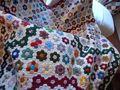 Renee has a large and colorful hexagon quilt with flowers.