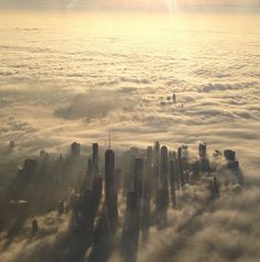 Flying into NYC this morning... the clouds were so low there was a city in the sky - Imgur