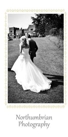 Slaley Hall Wedding Photography. A simple Bride & Groom Walking photo
