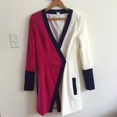 SALEVenus wrap jacket/dress. Fuschia white, blue Motivated to sell. Offers welcomed! Venus wrap jacket/dress. White/fuschia/blue. Size 4. Missing inside button. Small Mark on the front. (Shown in 3rd picture.) Office, business attire, work outfit, sophisticated chic professional no trades Venus Dresses