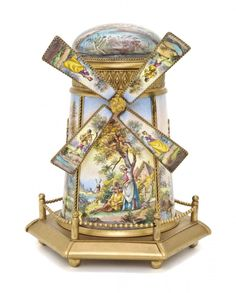 An Austrina enameled music box, in the form of a windmill, the enamels decorated with figural scenes