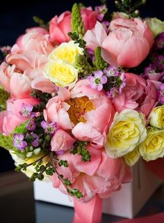 Love the pink salmon and yellow combination in this flower arrangement.