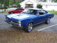 I know it's not a Mustang, but I really liked the 1966 Pontiac GTO. 67 Pontiac Gto, Old School Muscle Cars, 1966 Gto, Amazing Cars, Awesome, Gm Car, Sweet Cars, American Muscle Cars, Hot Cars