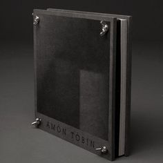 The Amon Tobin boxset is a strictly limited edition release and will come in the form of a beautiful high quality bolt fastened mechanical 'press'. Packed inside are 6 x vinyl, 7 x CD, 2 x DVD and several posters. Cd Cover, Music Covers, Playlist Creator, Cd Packaging, Experimental Music, Night Swimming, Music Logo, Amon, Angels And Demons
