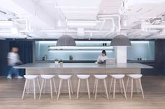 Can you design a workplace like you were writing a book? Bean Buro's latest project for UBER Hong Kong indicates that maybe you can.
