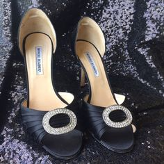 Manolo Blahnik Crystal Accent Heels Beautiful black satin heels with circle of crystals. So elegant and classy! Size 39. Includes box. Missing one stone. Shown in photo 2, but just like when wearing, the sparkly silver makes it very hard to notice. Manolo Blahnik Shoes Heels