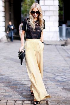 Poppy Delevigne // Wide-leg silk pants paired with an embellished evening top.