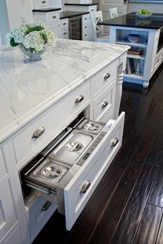 Refrigerated storage drawer, White cabinets, white marble counter top, dark ceramic wood look tile