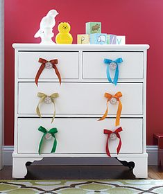 Love this simple idea for perking up a plain white dresser using colorful ribbons. How easy yet effective! It's a simple makeover idea you can complete in minutes using ribbon remnants. Don't have any leftover ribbon yourself? Ask friends and family. Discover more kids room decorating and organizing tips and ideas @ http://kidsroomdecorating.net