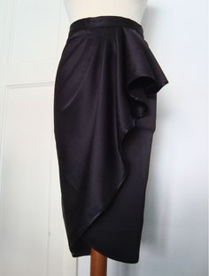 All NEW vintage draped tulip skirt in a beautiful black stretch sateen! Fastens at the back with a metal zipper which is both strong and stylish.  HOW TO ORDER: All items are made to order. So simply choose a set size from the drop down box OR If you would like your skirt made to measure then please send me your measurements, details below.  SIZE CHART: Please note that the hip measurement is taken from around the widest point Fabric has minimal stretch on the width  XS - Waist: 25-26inches…