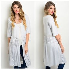 """SWEET & DELICATE DETAIL CARDIGAN This white cozy longline hem cardi boasts sweet details!  Half sleeve. Playful fringe dangles at the waist while above them a delicate circle of cut out design adorns. Thoughtful lines of tiny circles run the length to the hem. 97% polyester 3% spandex.  Small measures L40"""" B38"""" W34"""".  S (2) NO PAYPAL NO TRADES. Due to Poshmark's commission, price is FIRM unless bundled. All sales final. Tops Tunics"""