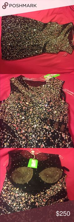 Black Mori Lee Short Homecoming Prom Dress Very beautiful Mori Lee Short Homecoming or Prom Dress! See through mesh on the sides and back! Only worn once! Push-up cups stitched in, but can be easily removed. Willing to negotiate price! Mori Lee Dresses Prom