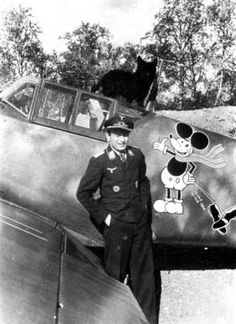 Luftwaffe ace Horst Carganico is pictured in the cockpit of his Bf. 109G-6. The photo was taken in either July or August 1942 and Carganico's Mickey Mouse emblen is seen clearly on the fuselage. Carganico joined the Luftwaffe in 1937 and was killed while attempting a forced landing near Chevry, France, on May 27, 1944. He was credited with downing 60 enemy aircraft and was a recipient of the Knight's Cross.