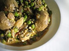 Mushroom Curry Simmered in a Fenugreek Cream Sauce with Green Peas -- spicy, creamy and wonderfully fragrant, this mushroom and pea curry with fenugreek leaves is delicious served on hot fresh cooked white rice or on Indian flatbreads