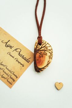 Wooden pendant solid wood bead wooden by AgniPrasadaBurning Wood Burning Crafts, Wood Burning Patterns, Wood Burning Art, Wood Crafts, Wooden Necklace, Wooden Earrings, Wooden Jewelry, Wooden Beads, Handmade Gifts