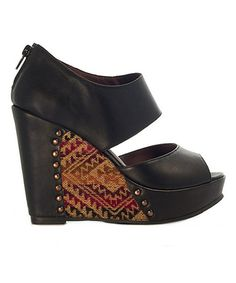 Sky-high meets artisan-inspired styling to create a wedge that stands out above the rest! The Peruvian pattern, leather construction and secure zipper closure make this open-toe pair a perfect pick for one-of-a-kind ensembles.Size note:This shoe runs large. Inca recommends ordering one size down.4.5'' hee...