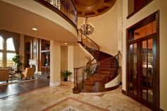 Stairs to indoor balcony Curved Staircase, Grand Staircase, Custom Home Builders, Custom Homes, Indoor Balcony, Grand Foyer, Luxury Interior Design, Fashion Room, Dream Rooms