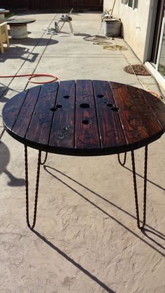 Rustic table made from cable spool. #spooltop #repurposed