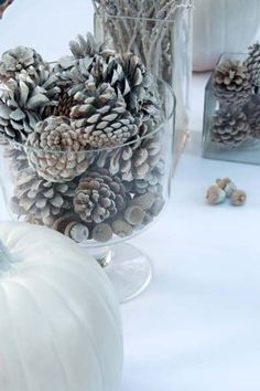 """Decorate with pine cones, twigs, acorns, and gourds, """"frosted"""" with flat white spray paint. Christmas Love, Rustic Christmas, Christmas Crafts, Holiday Centerpieces, Mason Jar Centerpieces, Centerpiece Ideas, Pine Cone Decorations, Christmas Decorations, Holiday Decor"""