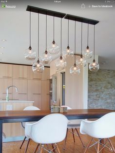 Firefly-Pendant-Lamp-dining-table - Home Decorating Trends - Homedit Dining Table Pendant Light, Lights Over Dining Table, Bar Dining Table, Dining Room Ceiling Lights, Kitchen Lighting Over Table, Dining Room Lamps, Dining Table Lighting, Dining Room Light Fixtures, Dining Rooms