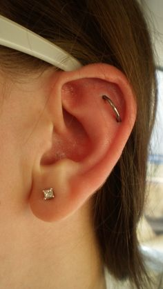 Helix Orbital Piercing - an orbital is an earring that goes through two parts of the ear