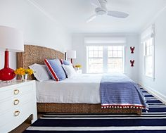 Coastal Bedroom. Coastal Bedroom with blue and white striped rug and navy and red decor.  #CoastalBedroom Chango & Co.