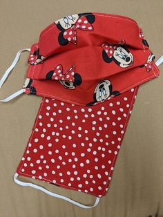 Reversible face mask Disney Minnie Mouse Mickey Mouse red   Etsy Baby Gift Sets, Baby Gifts, She Mask, Baby Burp Cloths, Halloween Face Mask, Pocket Pattern, Masks For Sale, Adult Children, Fun Prints