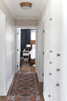 Tips & Tricks for Scoring Vintage Rugs Hallway with Wainscoting, Vintage Rug Runner, Built-In Linen Cabinet, Brass Light Fixture, and Floral Wallpaper Moulding And Millwork, Flur Design, Tadelakt, Hallway Designs, Hallway Lighting, Hallway Light Fixtures, Cottage, Hallway Decorating, Wainscoting