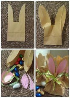 Com qualquer tamanho de saco kraft, recorte conforme o modelo e faça cestinhas decorativas em formato de coelho.