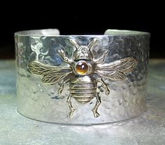 The Golden Bee -  wide statement cuff with solid brass bee and honey-colored rose cut citrine.  This one is my new favorite piece, and I've already ordered more of the fabulously cut citrine to use in other pieces.     ...from Lavender Cottage Jewelry