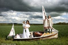 Earth mother: Jools is happy to be a stay-at-home mum to her large brood while Jamie works-cute photo shoot dont know how they think of them. love the girls dresses.