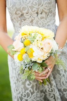 Bridesmaids bouquets contained shades of yellow, peach, and white // Casper Hamlet Photography