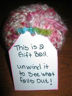 Surprise Filled Gift Balls.  This fun gift giving idea may look like just a ball of yarn, but it's really a bunch of little gifts wrapped layer by layer.  The recipient has to unwind the entire ball of yarn to receive all the gifts that are hidden inside!