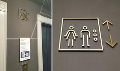 Custom water jet cut brass elevator wayfinding graphics.  251 Post Office Building, San Francisco, California — 505Design – Environmental Graphics