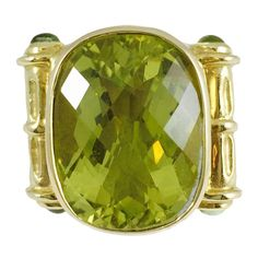 Impressive Peridot gold Ring   From a unique collection of vintage fashion rings at https://www.1stdibs.com/jewelry/rings/fashion-rings/